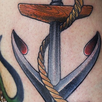 Татуировка женская олд скул на руке якорь