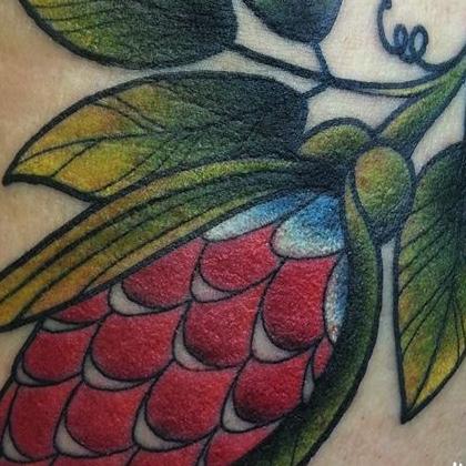 Татуировка женская олд скул на руке растения
