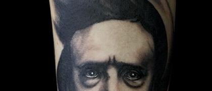 Татуировка мужская хорор на предплечье портрет