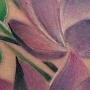 Татуировка женская акварель на бедре цветы
