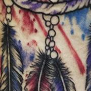 Татуировка мужская графика на предплечье индейская