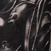 Татуировка мужская графика на плече собака