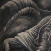 Татуировка мужская хорор на плече монстр