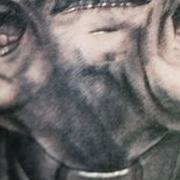 Татуировка мужская хорор на предплечье священник