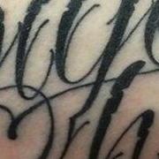 Татуировка мужская каллиграфия на предплечье надпись