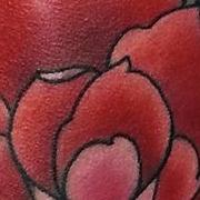 Татуировка женская нью скул на ноге роза
