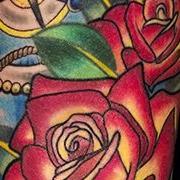 Татуировка женская олд скул на предплечье роза