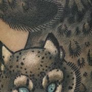 Татуировка женская олд скул на предплечье барс