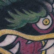 Татуировка мужская орнамент на боку дракон
