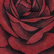 Татуировка женская олд скул на бедре роза