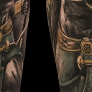 Татуировка мужская реализм на голени анубис