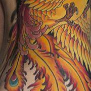Татуировка женская япония на боку феникс
