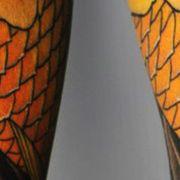 Татуировка мужская япония на предплечье рыбы