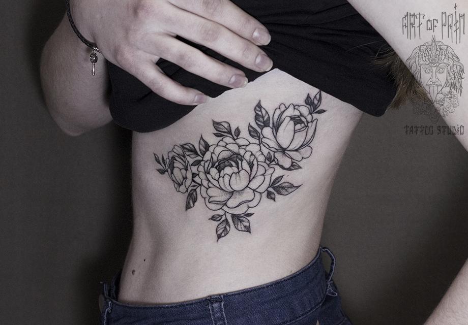 татуировки фото на ребрах