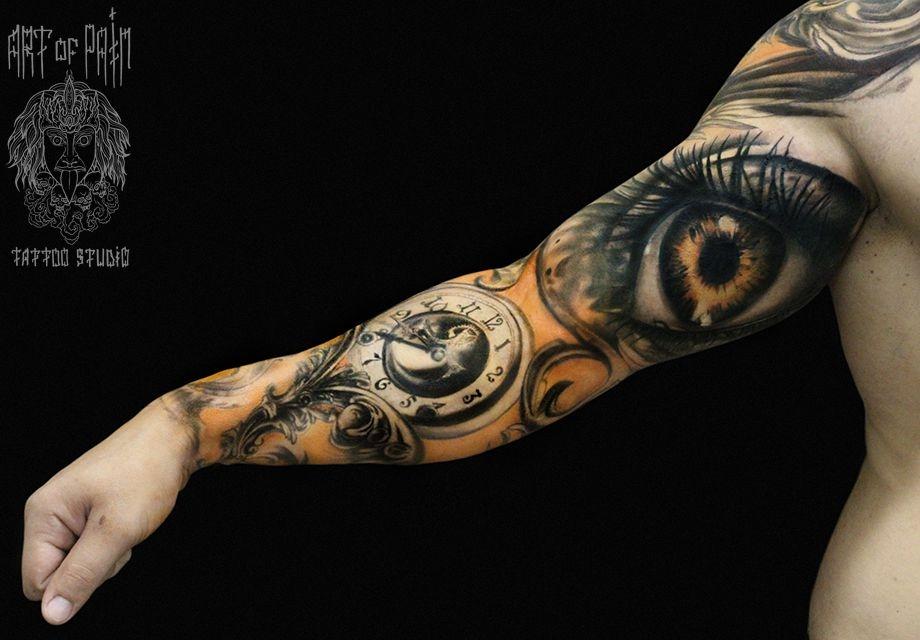 Татуировка мужская рукав в стиле реализм «Часы и глаз» – Мастер тату: Слава Tech Lunatic